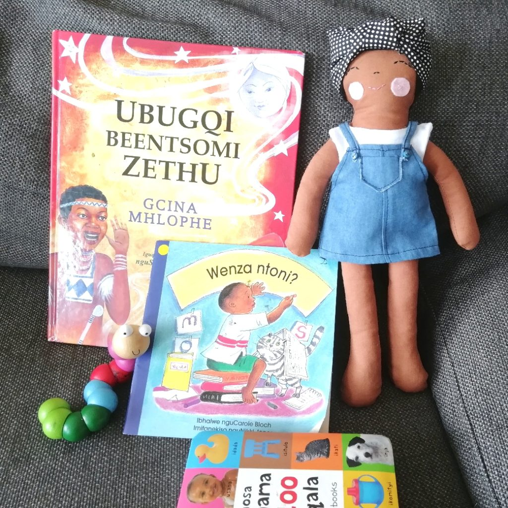 Brown doll with some favorite books