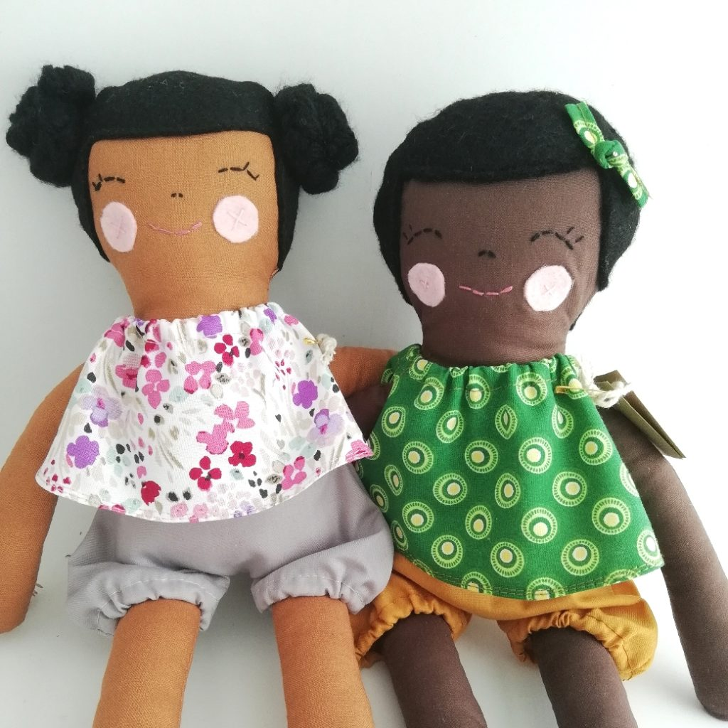 Two brown dolls in frills Tops and shorts- spring additions