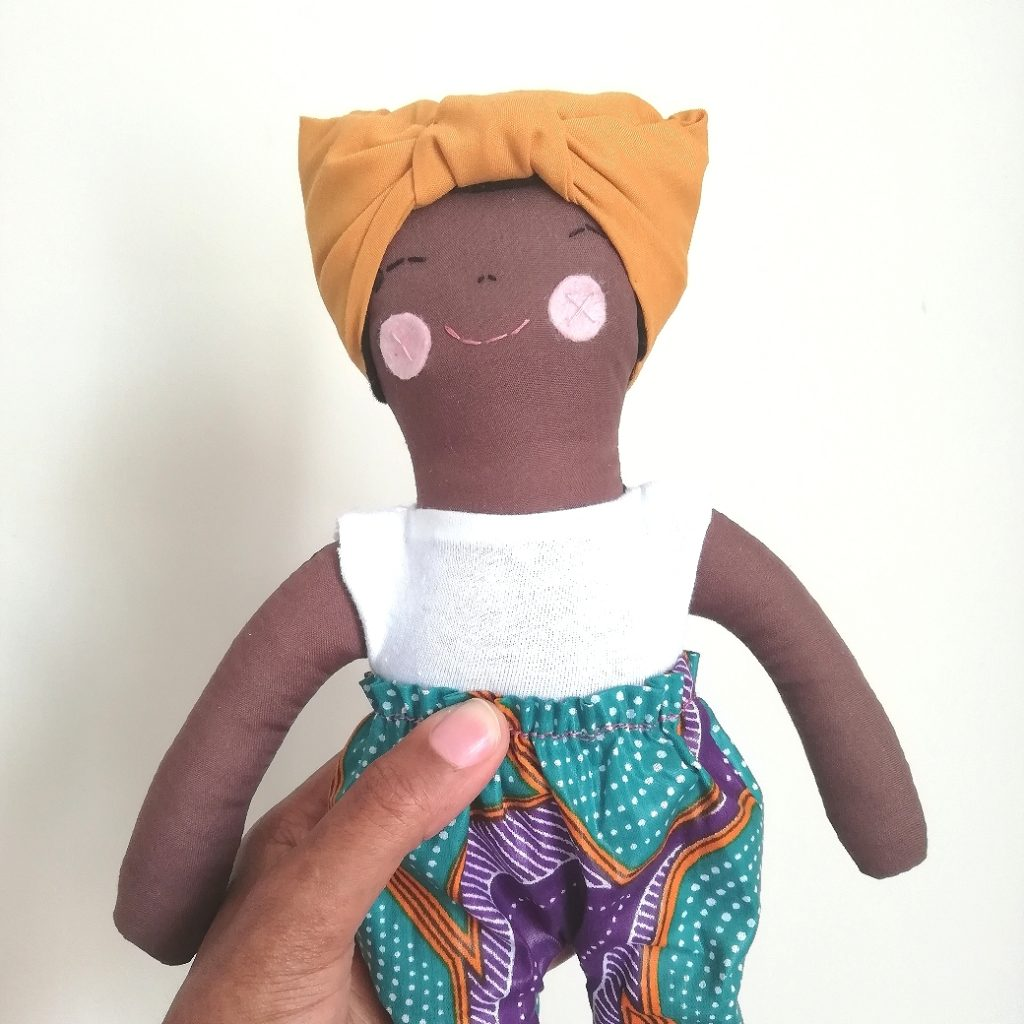 brown doll in pant
