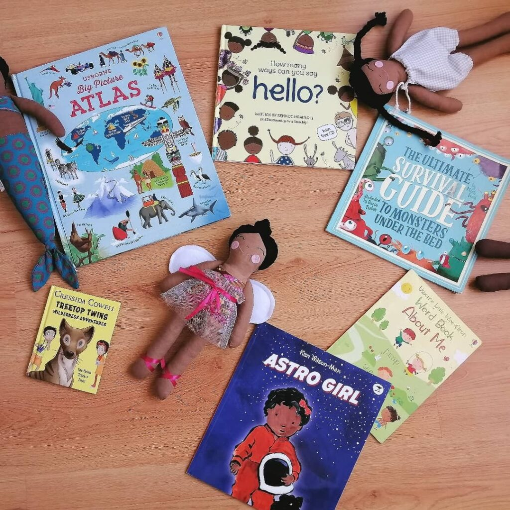 diverses books and dolls